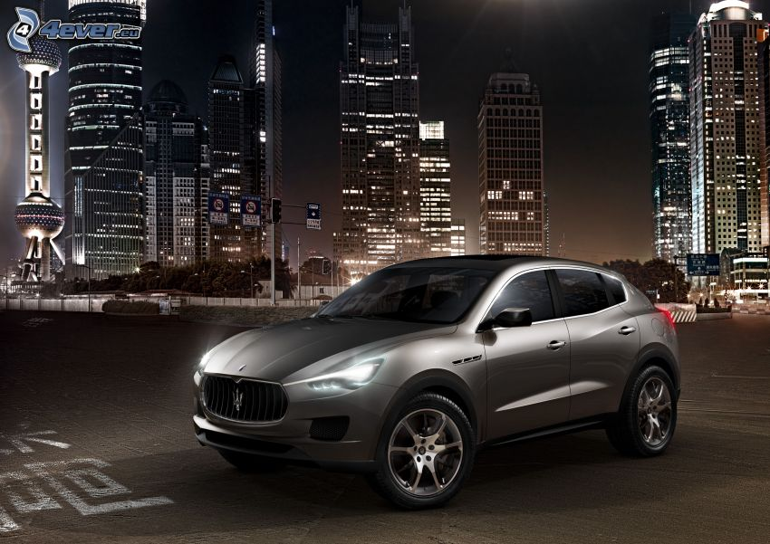 Maserati Levante, night city, skyscrapers