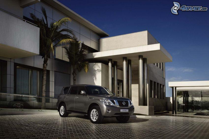 Nissan Patrol, modern house, palm trees, pavement