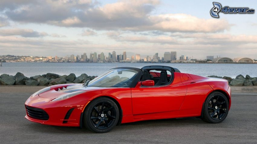 Tesla Roadster, convertible, silhouette of the city, sea