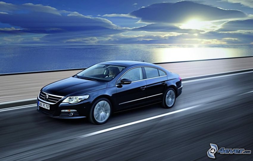 Volkswagen Passat CC, clouds over sea, sun behind the clouds