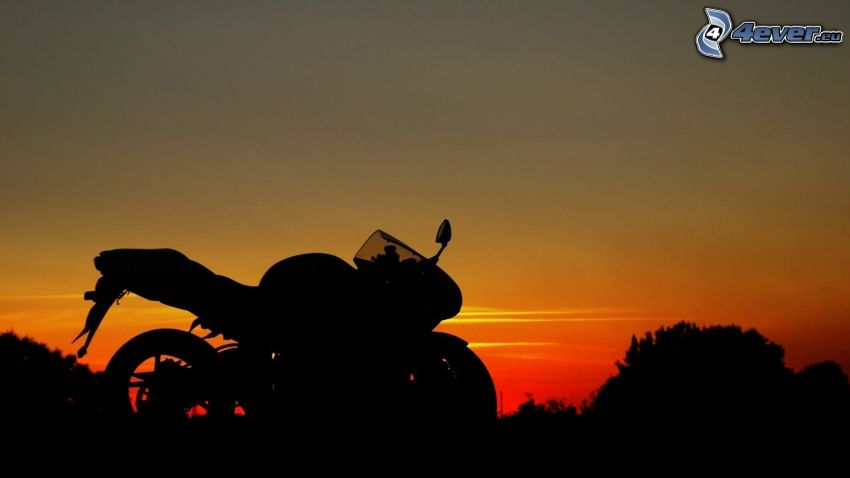 silhouette of the motorbike, evening dawn