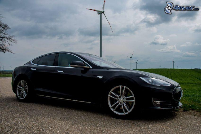 Tesla Model S, wind power plant, the dark clouds