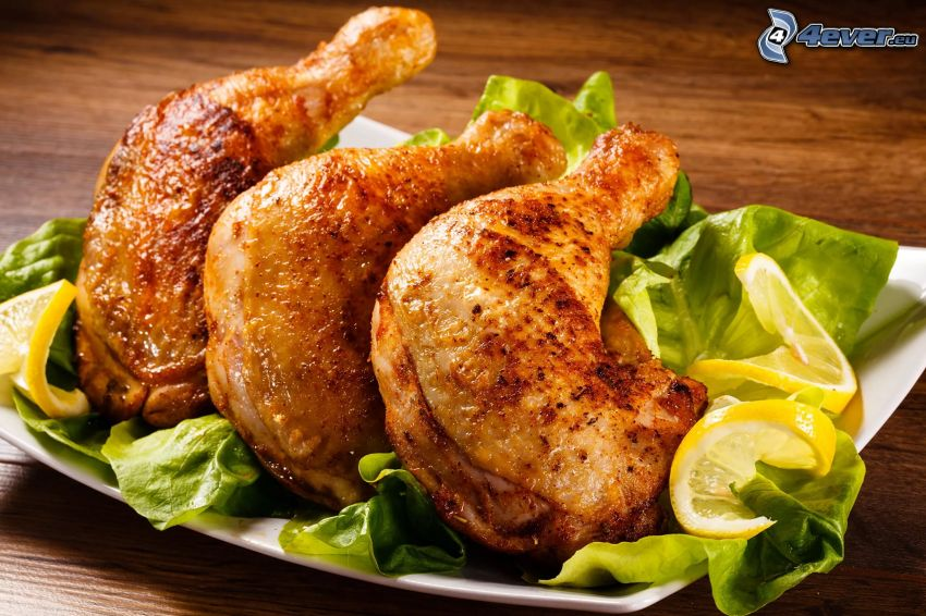 baked chicken, salad, lemon slices