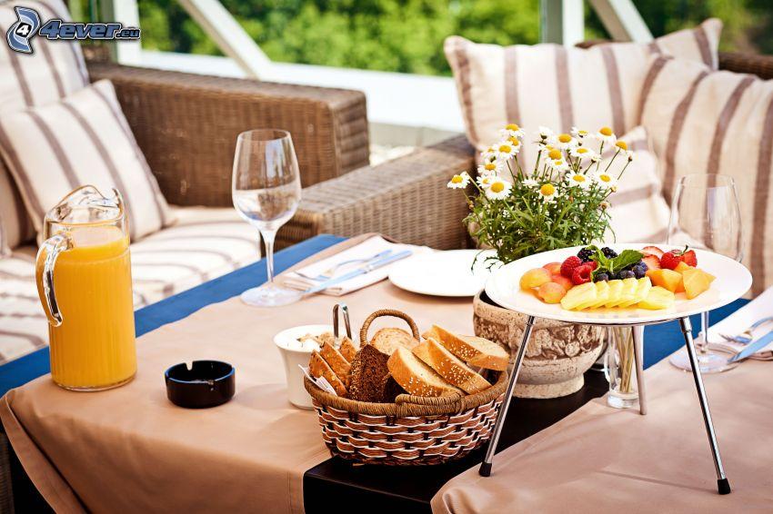 breakfast, sofa, fruit, bread, orange juice