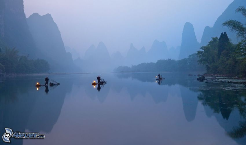 River, raft, men, mountains, fog