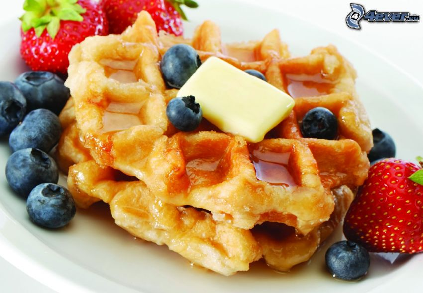 waffles, blueberries, strawberries, butter