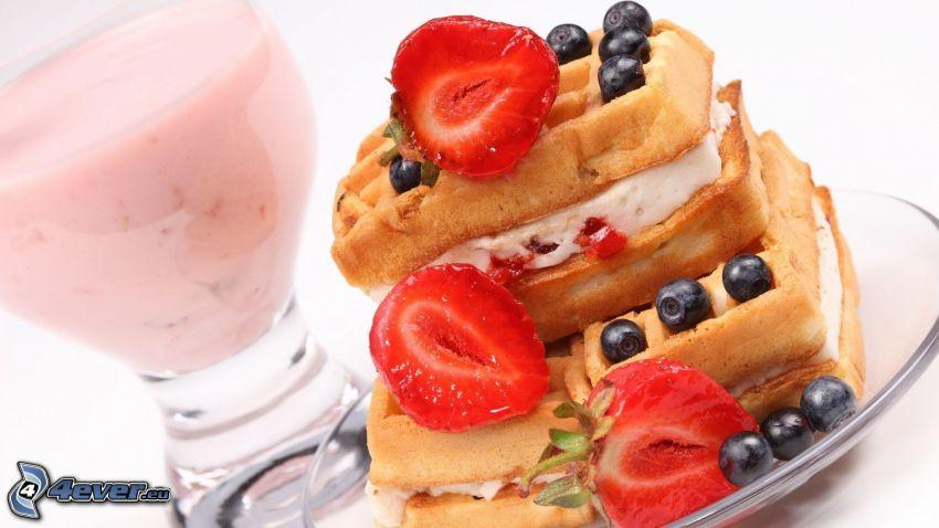 waffles, strawberries, blueberries, milk shake