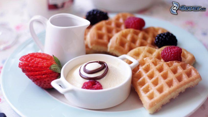waffles, strawberry, raspberries, blackberries, cream