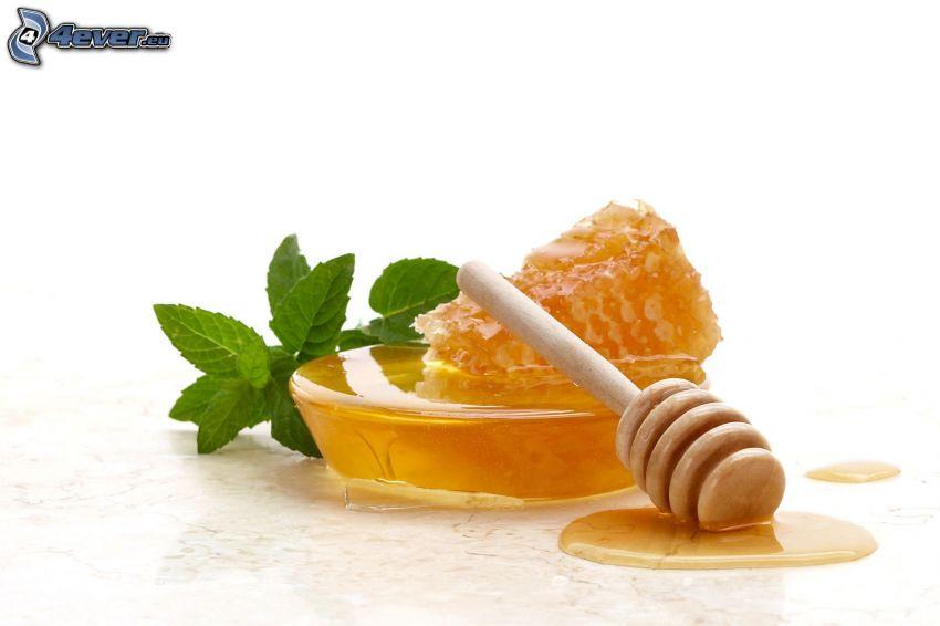wooden honey stick, honey, beeswax, mint leaves