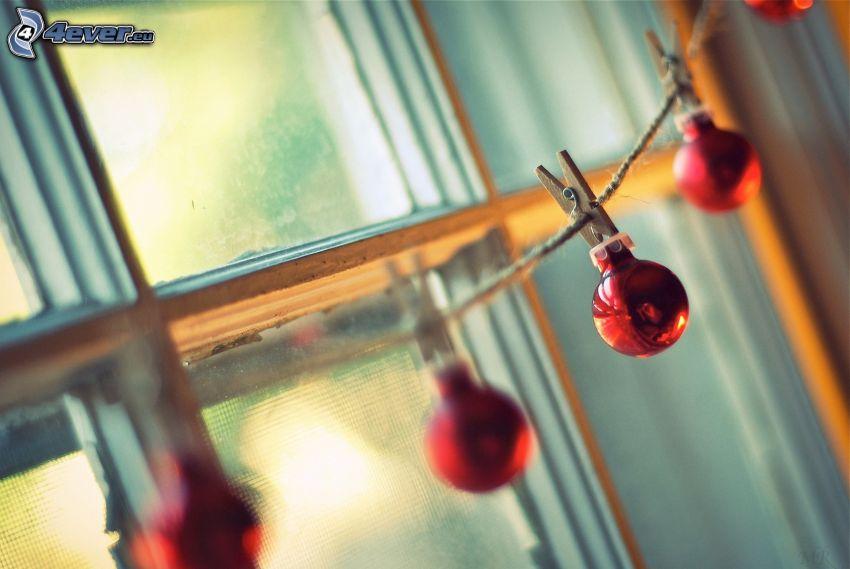 christmas balls, clothesline, pegs