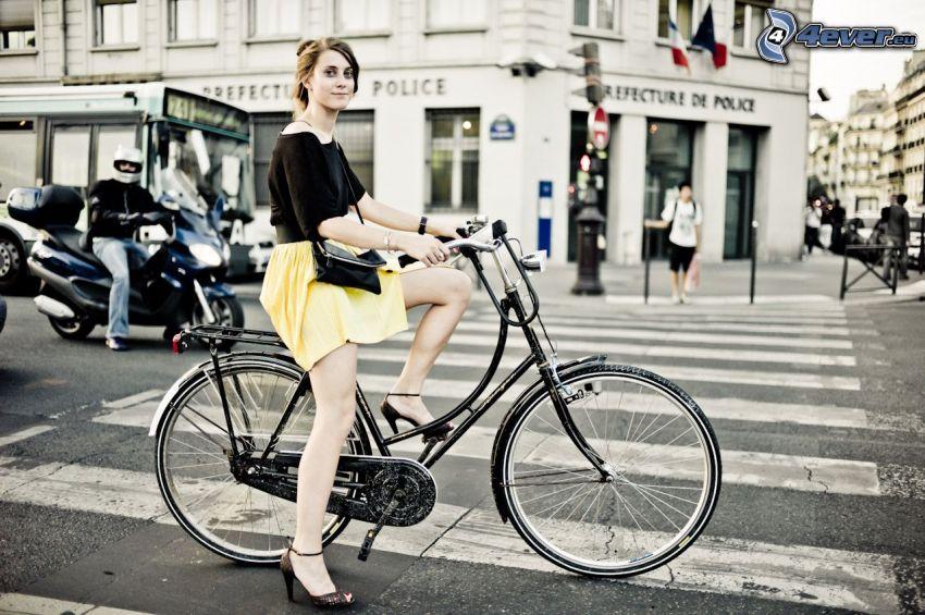 girl on bike, Paris, zebra crossing