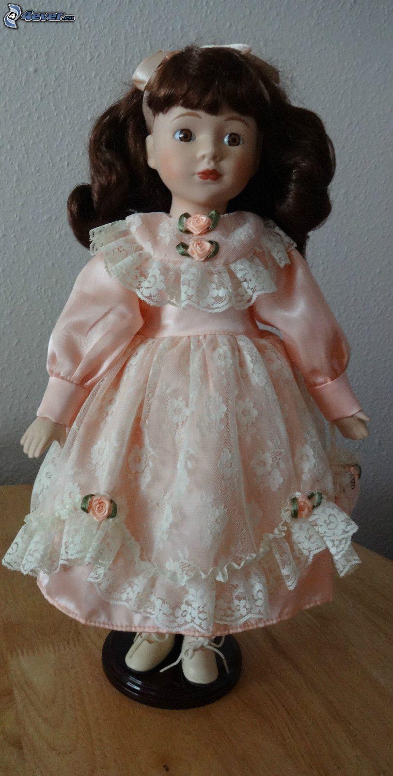 porcelain doll, pink dress