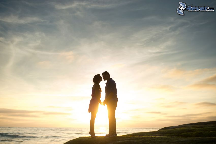 couple, kiss, sunset over the sea, silhouette of couple