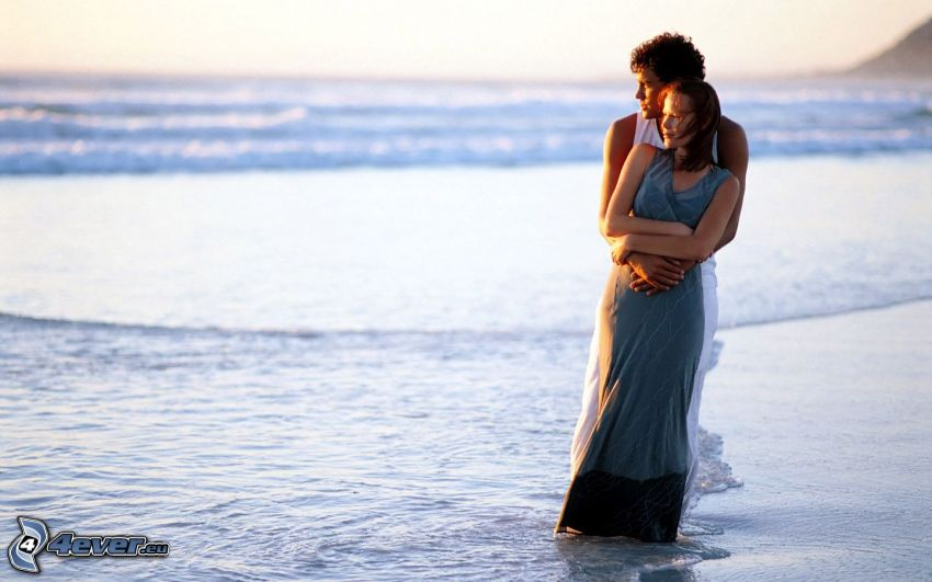 couple by the sea, gentle embrace