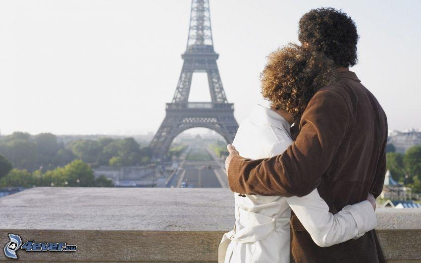 couple in embrace, Eiffel Tower, Paris, France