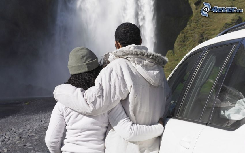 couple in embrace, waterfalls