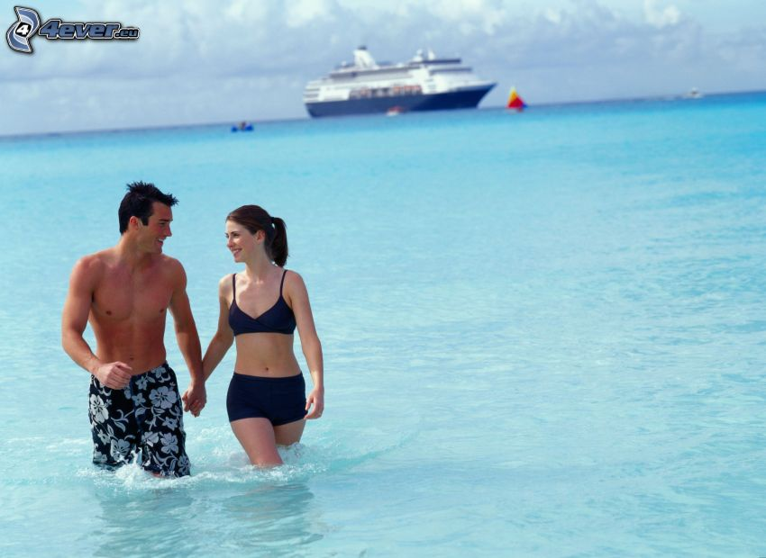 couple in the sea, holding hands, cruise ship