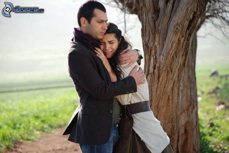 couple near the tree, hug, sadness