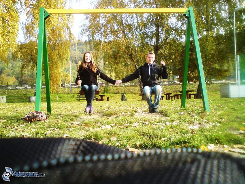 couple on seesaw, love, park