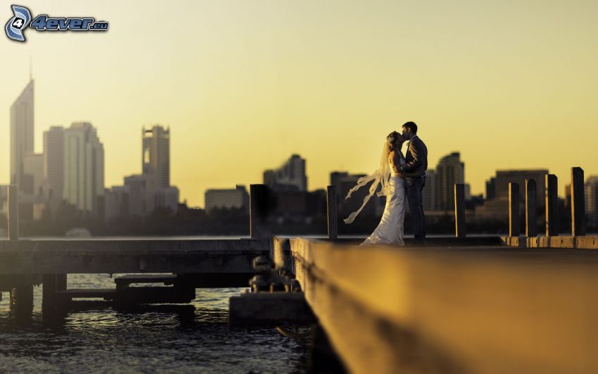 newlywed, kiss, couple in town, romance, pier, city