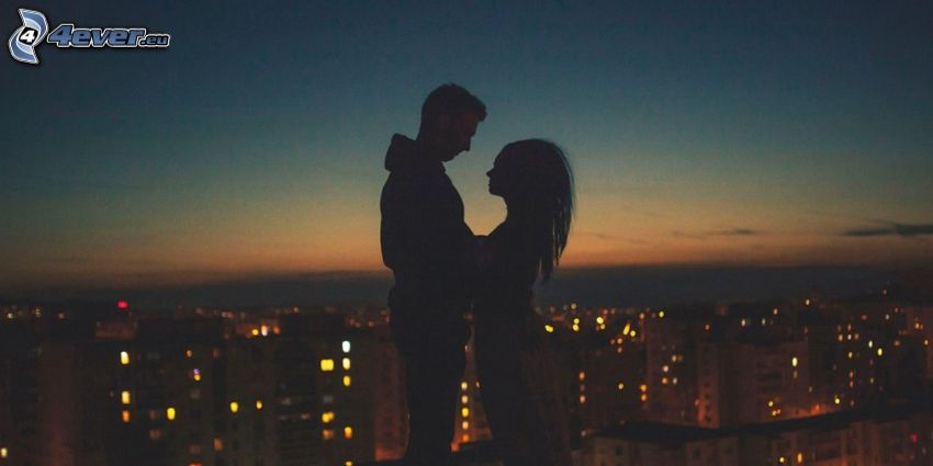 silhouette of couple, night city