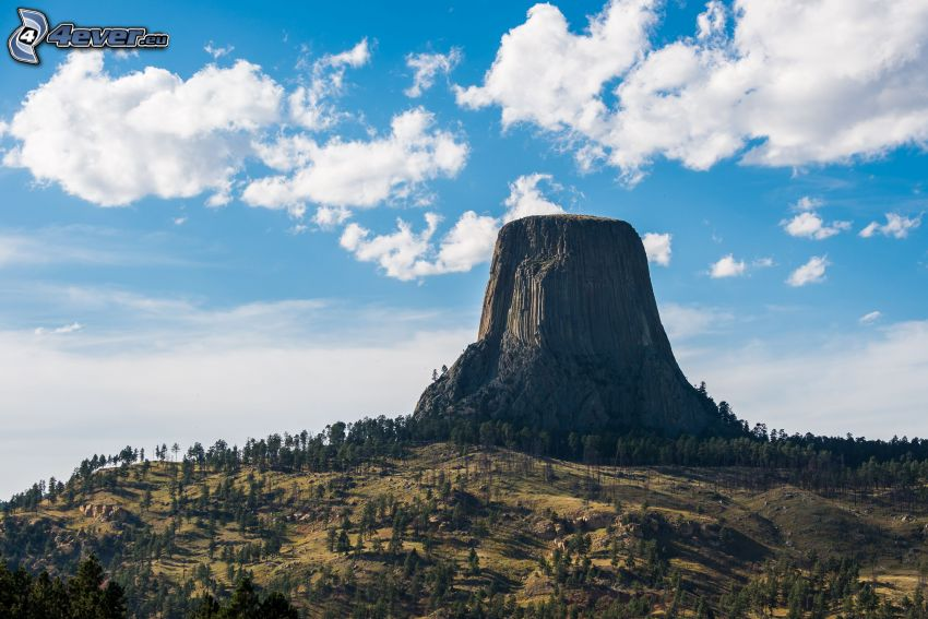 Devils Tower, rock, forests and meadows, clouds