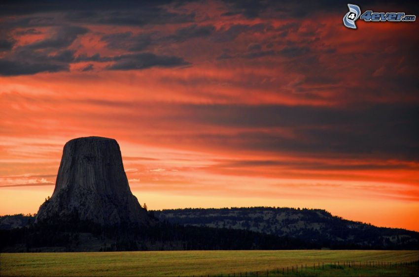 Devils Tower, rock, red sky, clouds, meadow