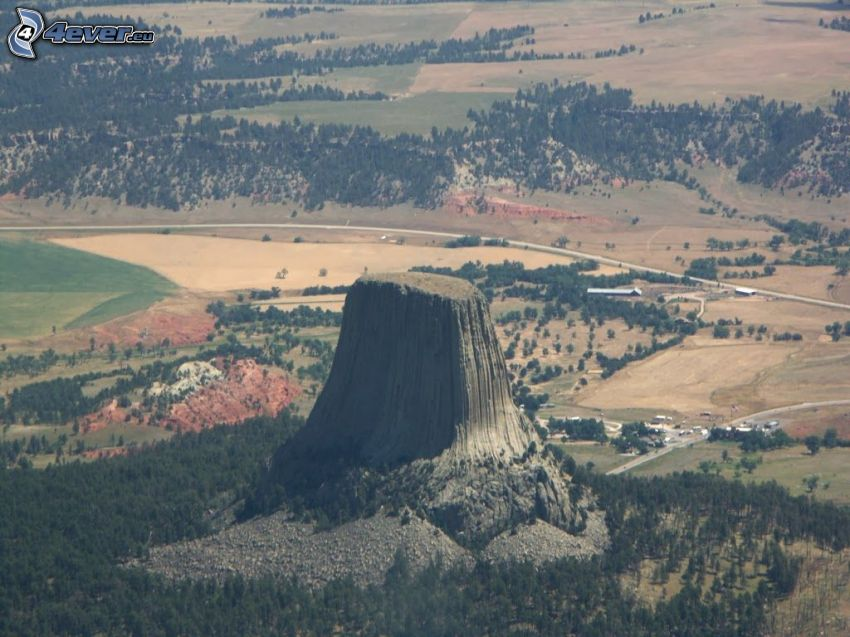 Devils Tower, rock, road, forests and meadows