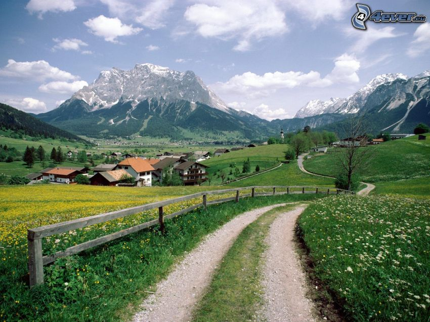field path, rocky mountains, palings, meadows, houses