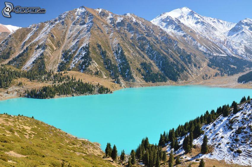 Kolsai Lakes, mountain lake, snowy hills