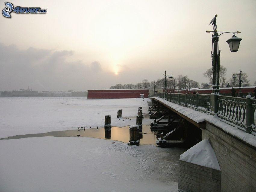 frozen lake, snow, pedestrian bridge