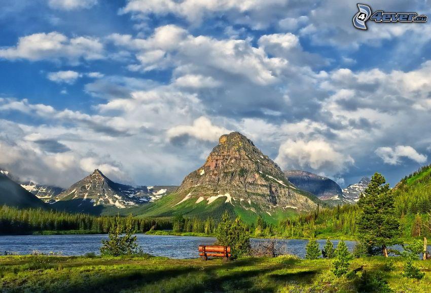 Glacier National Park, rocky mountain, clouds, lake, bench