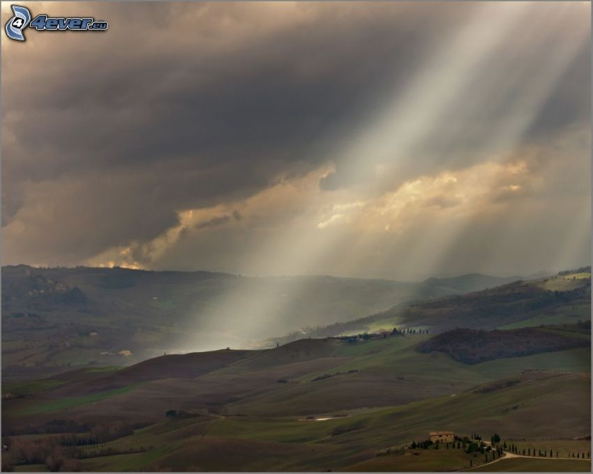 hills, sunbeams, clouds