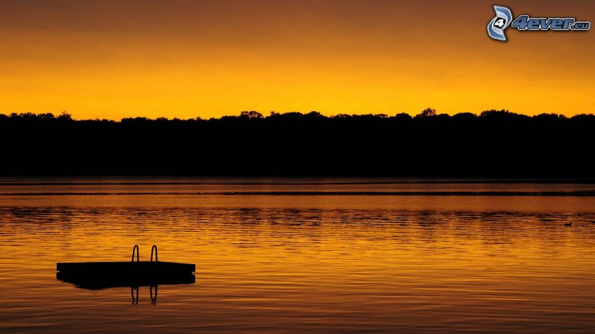 lake, evening dawn, silhouettes of the trees