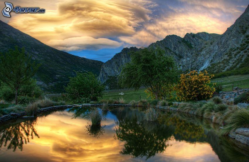 lake, rocky hills, evening