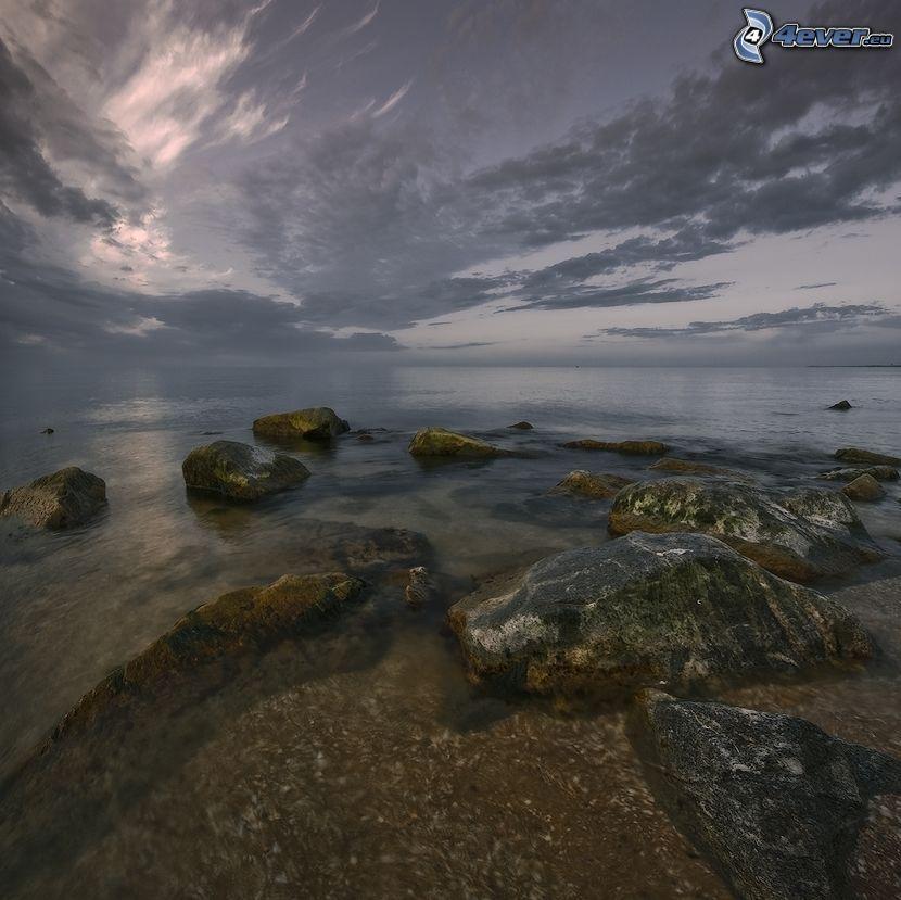 rocks in the sea, clouds
