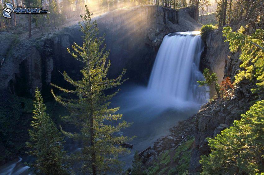 waterfall in the forest, rocks, trees, sunbeams