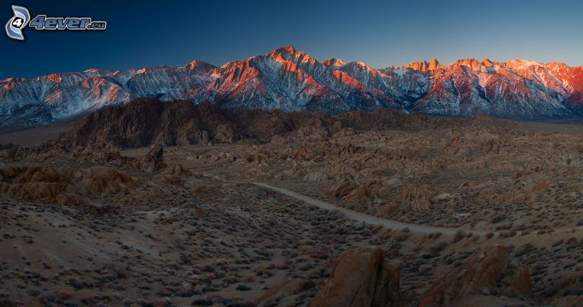 arid desert landscape, snowy mountains