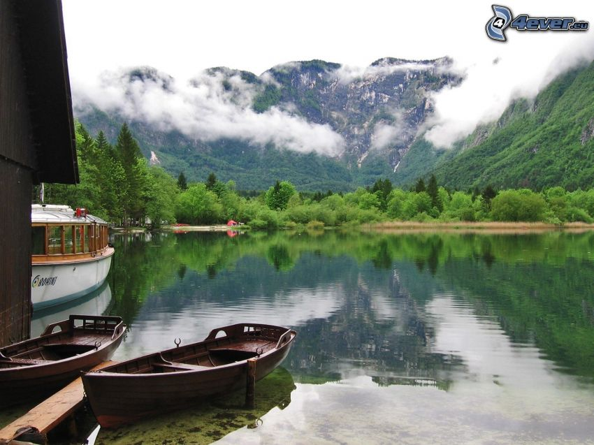 boat on the river, wooden boat, mountains
