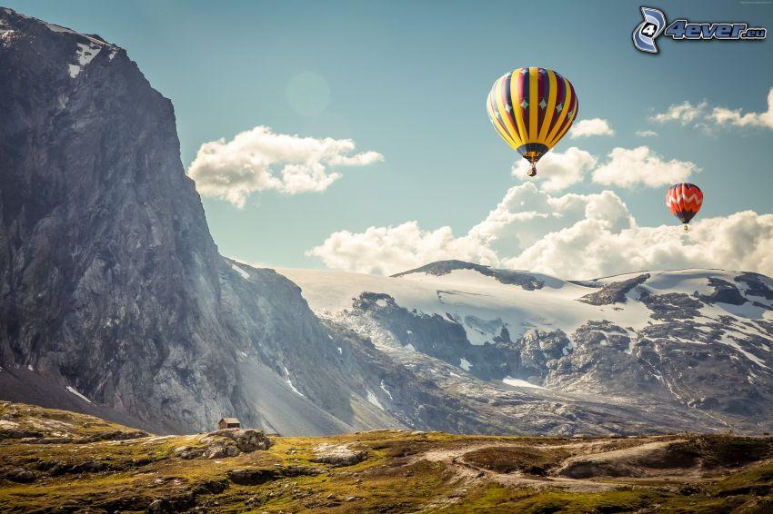 hot air balloons, snowy mountains, rocky mountains