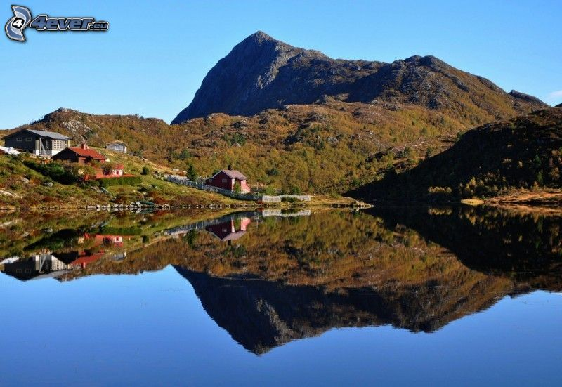 rocky hill, houses, water, reflection