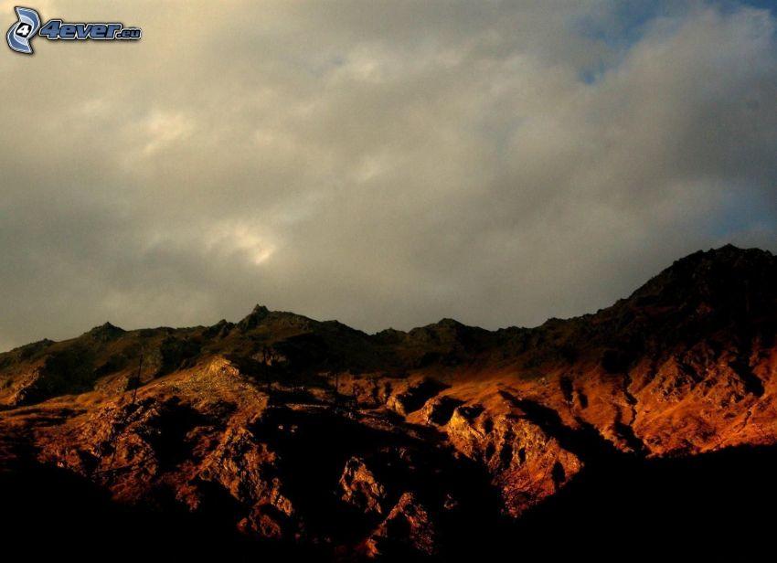 rocky hills, clouds
