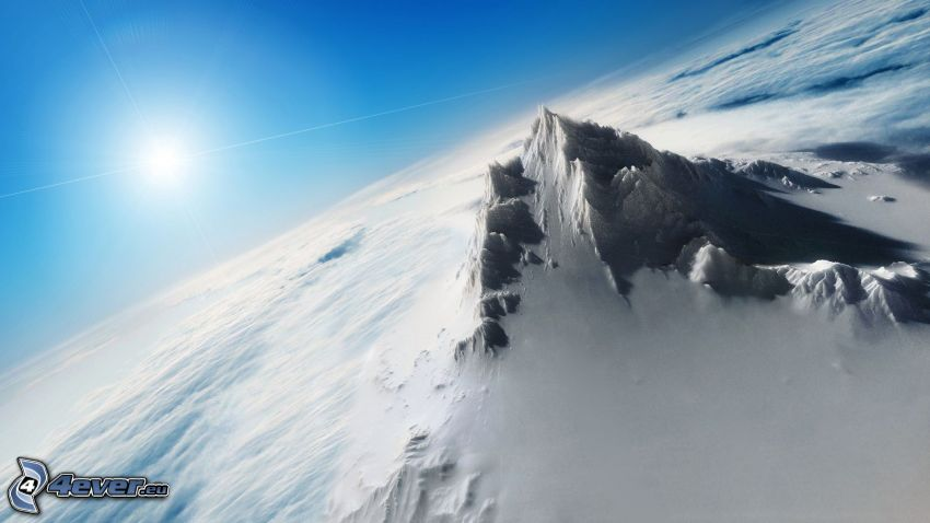 snowy hill, over the clouds, sun