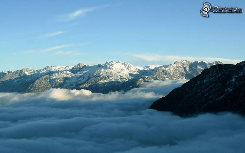 snowy mountains, over the clouds