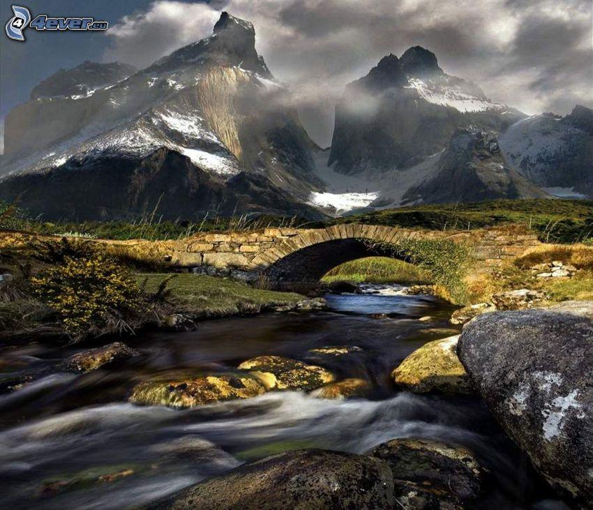 stone bridge, stream, boulders, snowy mountains, high mountains, rocky mountains