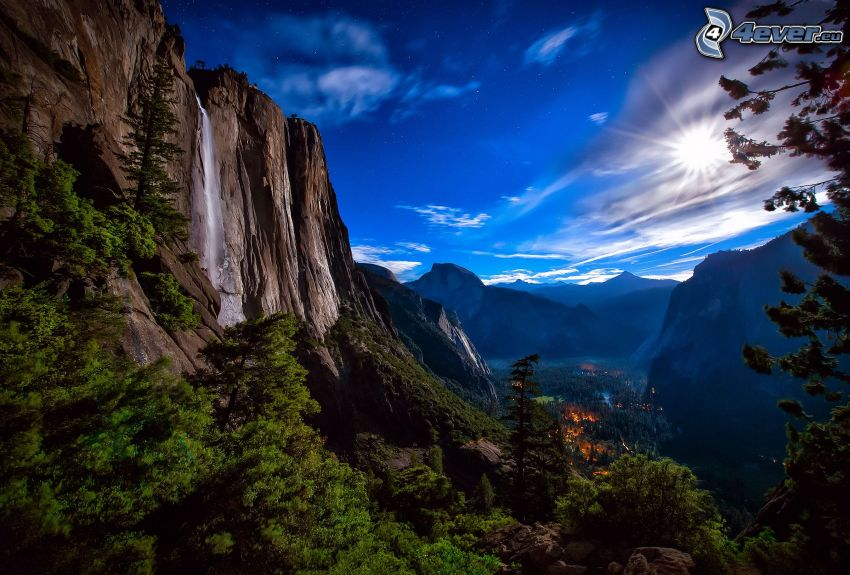 Yosemite National Park, rocky mountains, green trees, waterfall, sun