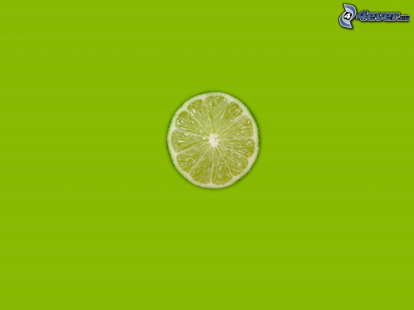a slice of lime, green background
