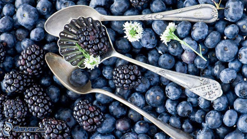 blackberries, blueberries, spoons