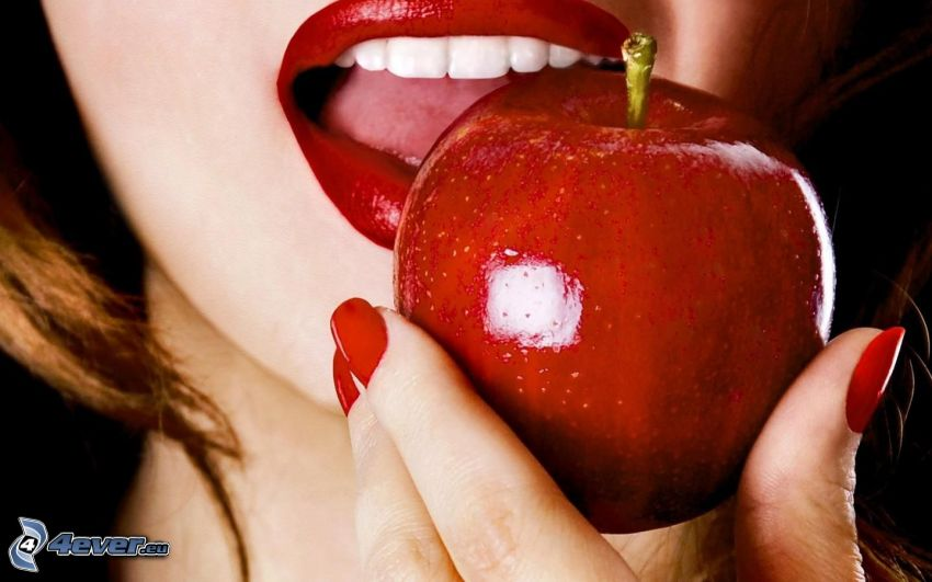 red apple, mouth, painted nails