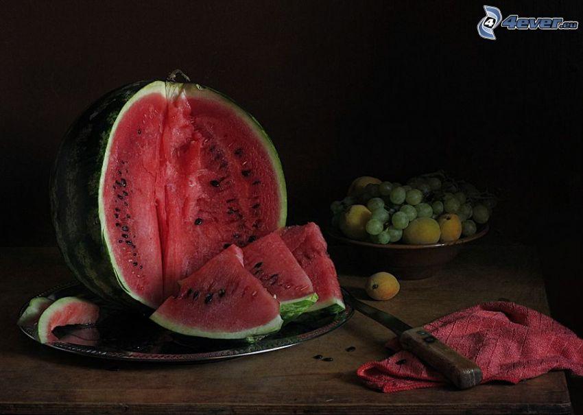 watermelon, grapes, peaches, knife